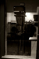 The big enlarger sits in the window waiting to move into the darkroom